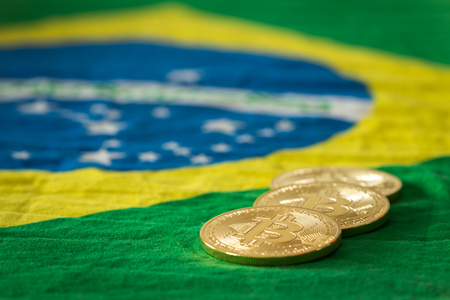 bitcoins on the background of the Brazilian flag Stock Photo