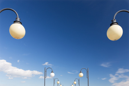 Street lamps on the background of a cloudy sky 免版税图像