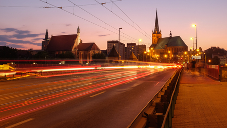 Szczecin after sunset. Urban lights illuminating the city center. View from the long bridge