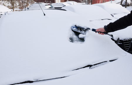 Winter, clearing the car.