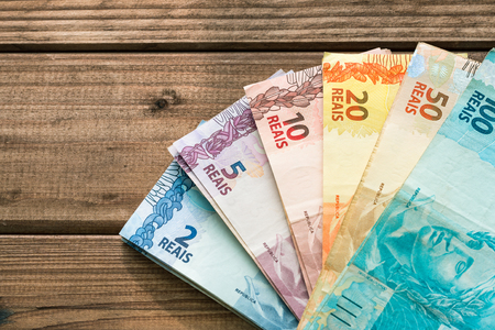 Brazilian money on a wooden background