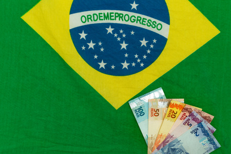 Brazilian money on the background of the flag Banque d'images