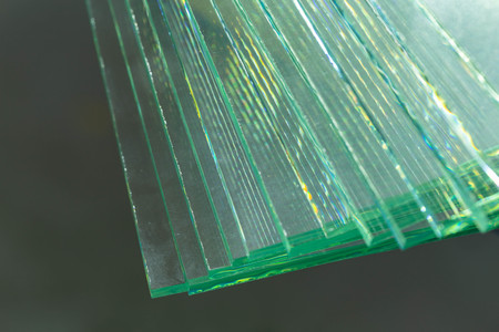Pieces of transparent glass stacked on each other and creating reflections Stock Photo