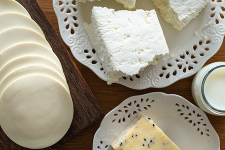 Yellow and white cheese on the kitchen table