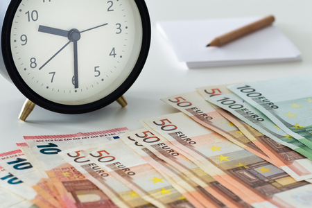 European currency, Euro money with alarm clock, card and pencil