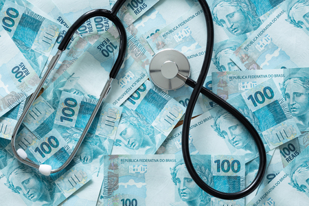 Brazilian money with a medical stethoscope