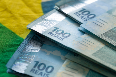 Brazilian money, denominations of 100 reais Фото со стока