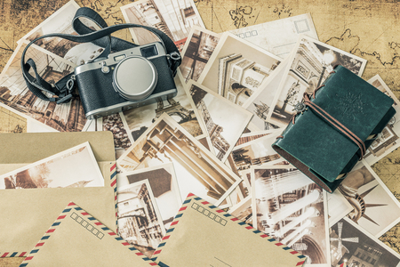 Holiday memories. Old postcards with a map, photo camera and travel notebook