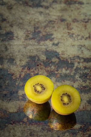 cut of golden kiwi fruit, Place for text