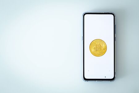 smartphone with Bitcoin on the screen and with space for text