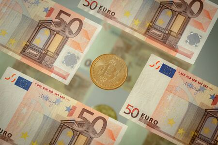 European money, banknotes 50 euro and virtual currency bitcoin Zdjęcie Seryjne