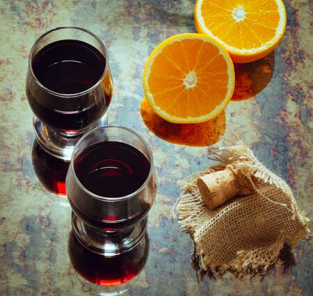 two glasses of wine and pieces of orange, photo in vintage style Zdjęcie Seryjne