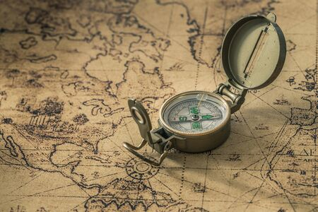 a compass on an old map showing the direction
