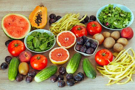 healthy diet, kitchen table full of fruits and vegetables