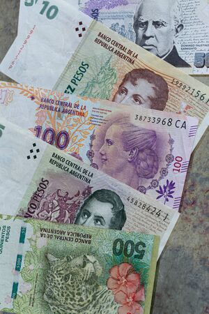 Argentine money, banknotes of various denominations. Weakness of reality, state crisis, concept