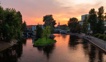 Bydgoszcz. Sunset over the walking boulevards on the river Brda