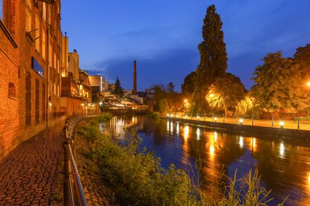 Bydgoszcz by night. Old buildings on the river Brda. A place called Bydgoszcz Venice