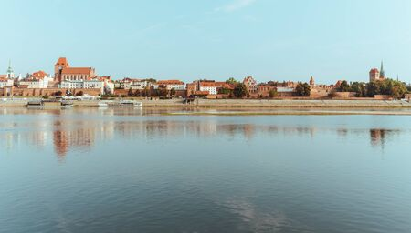 Torun. View from behind the Vistula River to the old medieval city walls and architecture. poland
