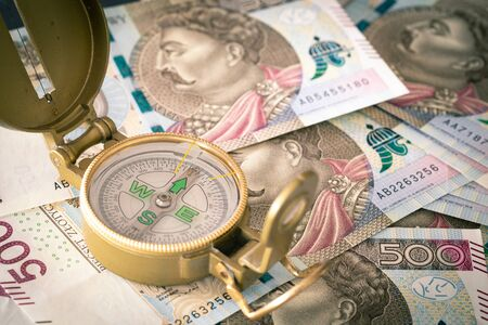 Polish money, 500 zloty Banknotes and compass  business direction concept