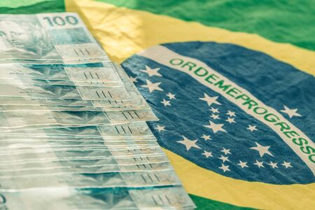 Brazilian money, 100 reais banknote with the National flag