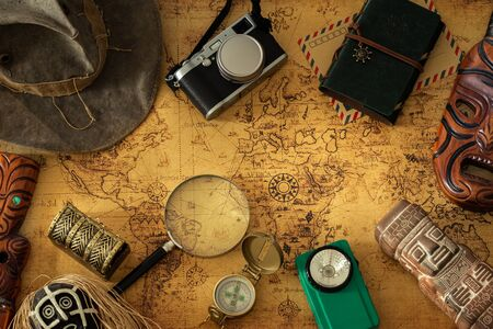 Old map, vintage travel equipment and souvenirs from around the world