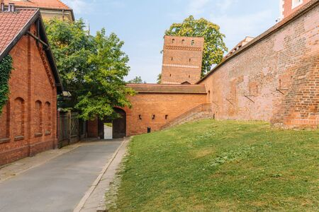 The leaning tower in Torun. Medieval city walls Stock Photo