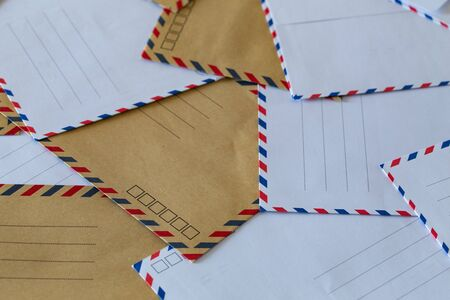 unaddressed stylish envelopes. The concept of letters, parcels and mail