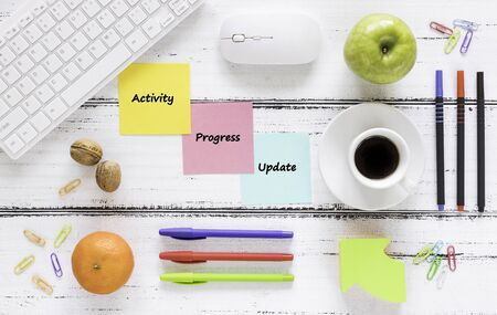 a workplace with colorful, motivating, saved cards. Concept, Achievement improvement. Keyboard, healthy snack, pens, bright background.