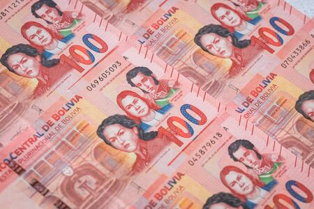 Bolivian money. Various banknotes spread out on a table