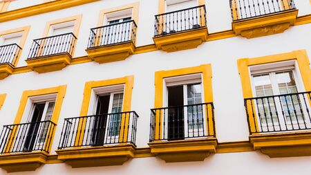 Traditional yellow and white colors of the architecture of Barrio Santa Cruz in Seville