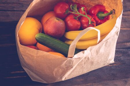 ecological paper bag full of fruits and vegetables