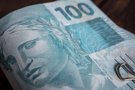Wad of 100 reais Brazilian banknotes Reklamní fotografie