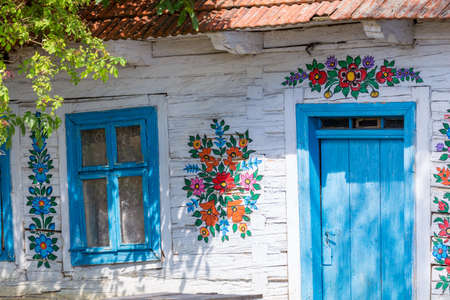 Traditionally painted houses with floral motifs. The Colorful Village of Zalipie in the Lesser Poland Voivodeship. Poland. 9 August 2020