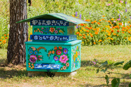 Traditionally painted hives with floral motifs. The village of Zalipie, Lesser Poland Voivodeship. Poland. 9 August 2020