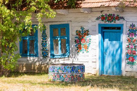 Traditionally painted houses. Flower motifs. The village of Zalipie, Lesser Poland Voivodeship. Poland. 9 August 2020