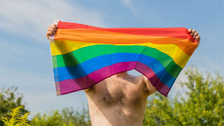 man spreading an LGBT flag in support of the movement Reklamní fotografie