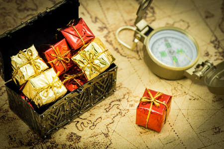 old chest full of gifts, compass, treasure hunt concept