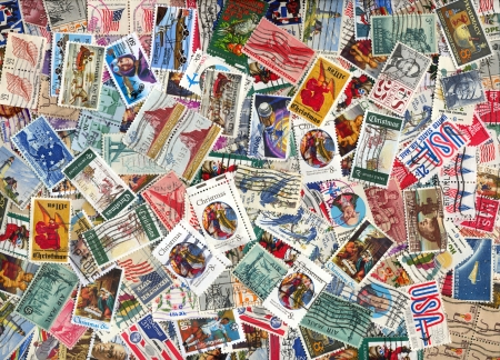 background of miscellaneous old used vintage U.S. postage stamps