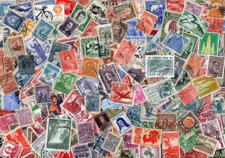 vintage background of old used Cetral and South American postage stamps