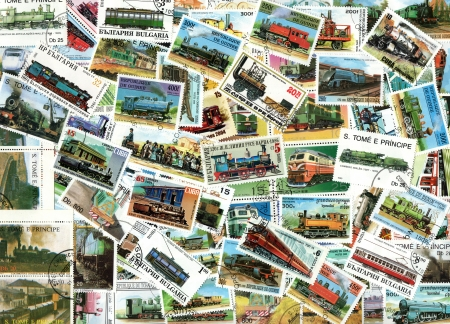 Trains and steam engines - background of old used postage stamps from various countries worldwide