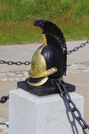 Cuirassier helmet on a plinth in Borodino, Russia Editorial