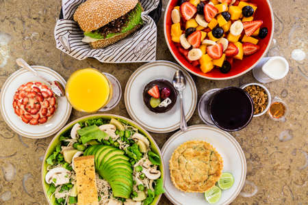 Poke bowl with lettuce, avocado and cheese Sandwich with ham and cheese. Sweet desserts with chocolate and fruits. Healthy drinks.