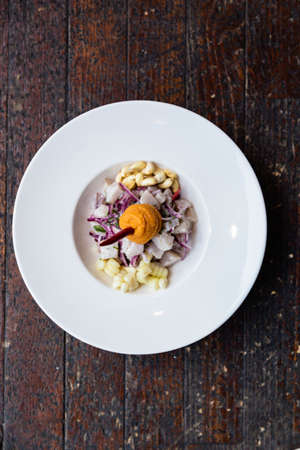 Ceviche with sweet potato, white corn and red onion. Peruvian food in the Mediterranean of the island of Majorca.