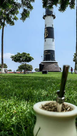 Drinking mate in the malecon of Lima, in front of the lighthouse.
