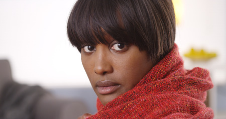 ebony: Sultry black woman wearing red blanket