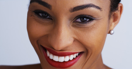 red lips: Happy black woman smiling and looking at camera Stock Photo