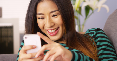 Asian woman using smartphone Standard-Bild