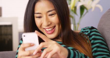 Asian woman using smartphone Archivio Fotografico