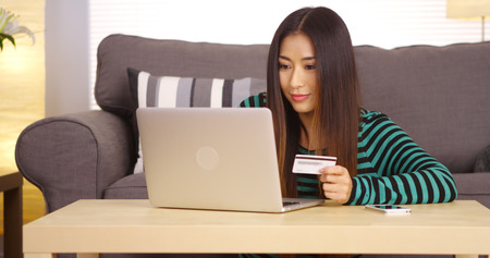 'young things': Japanese woman buying things online Stock Photo