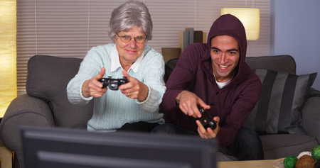 mature mexican: Elderly woman playing videogames with Hispanic man